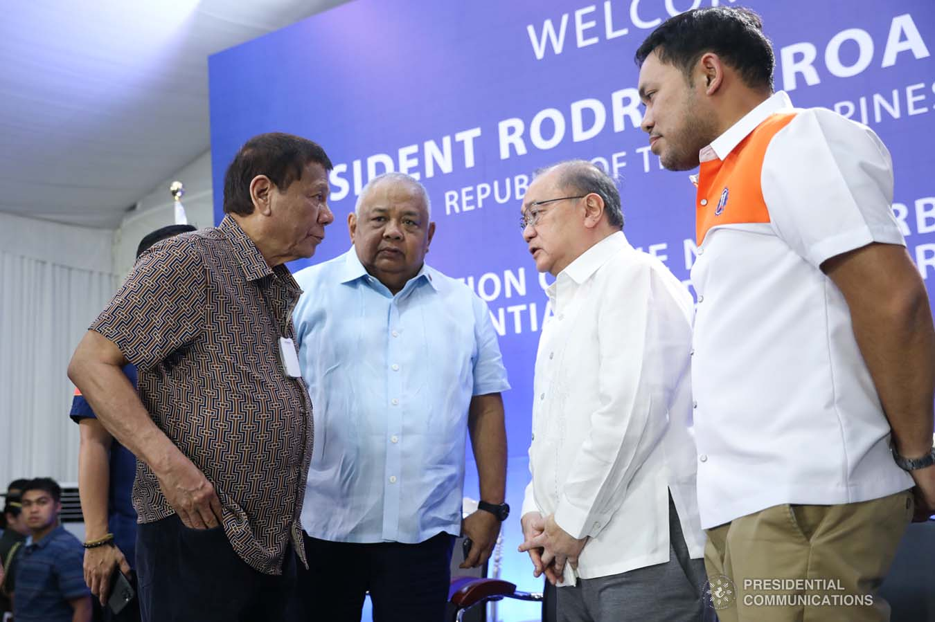 President Rodrigo Roa Duterte discusses matters with Executive Secretary Salvador Medialdea, Metro Pacific Investments Corporation Chairman Manuel Pangilinan and Public Works and Highways Secretary Mark Villar after leading the inspection of the North Luzon Expressway (NLEX) Harbor Link Circumferential Road 3 (C3)-R10 Section in Caloocan City on March 5, 2020. SIMEON CELI JR./PRESIDENTIAL PHOTO