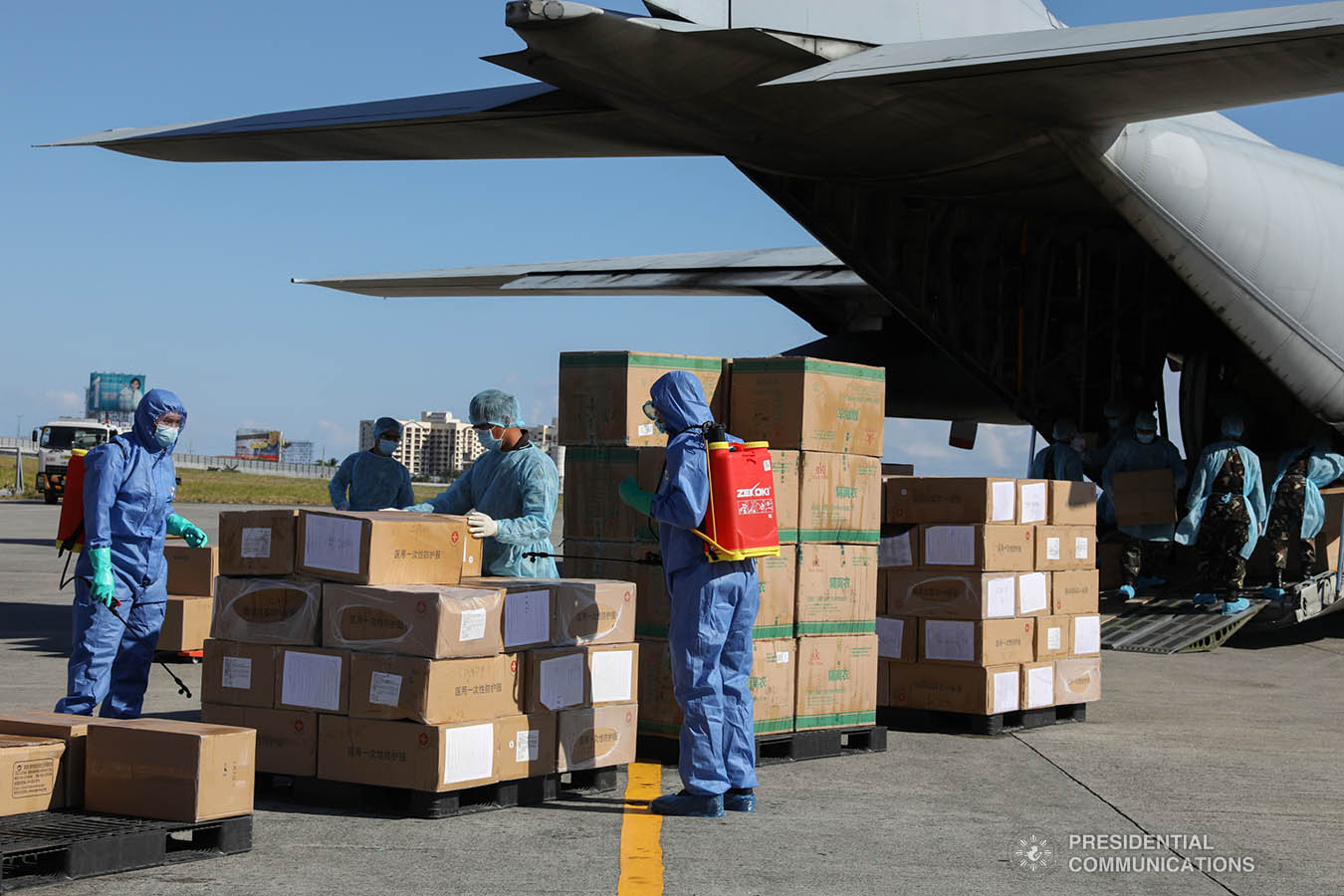 The aid packages donated by the People's Republic of China undergo disinfection upon arrival at the Villamor Air Base in Pasay City on March 21, 2020. The donation includes assorted medical supplies, personal protective equipment, and testing kits for coronavirus. TOTO LOZANO/PRESIDENTIAL PHOTO