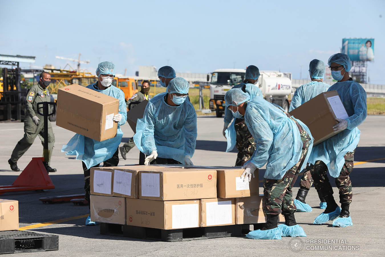 Thousands of aid packages donated by the People's Republic of China are unloaded at the Villamor Air Base in Pasay City on March 21, 2020. The donation includes assorted medical supplies, personal protective equipment, and testing kits for coronavirus. TOTO LOZANO/PRESIDENTIAL PHOTO