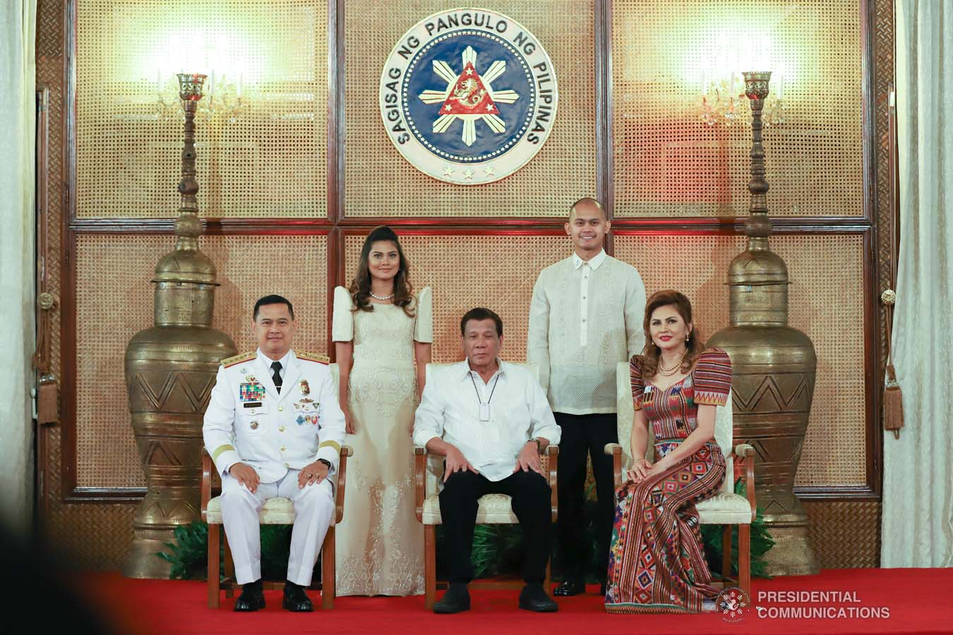 President Rodrigo Roa Duterte poses for posterity with Philippine National Police (PNP) chief  General Archie Gamboa and his family during the oath-taking ceremony of the newly appointed Generals and Flag Officers of the Armed Forces of the Philippines and Star Rank Officers of the PNP at the Malacañan Palace on March 11, 2020. REY BANIQUET/PRESIDENTIAL PHOTO