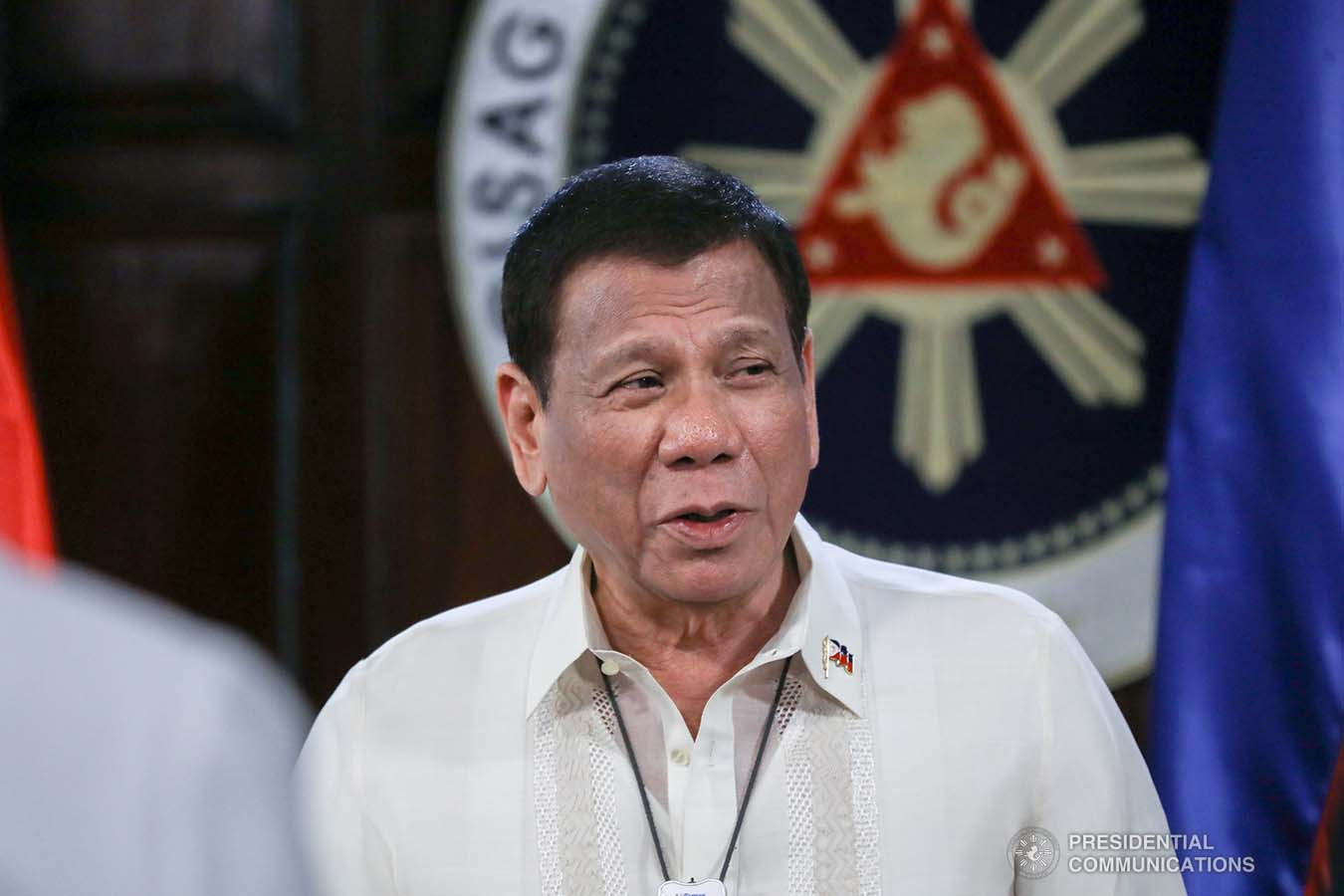 President Rodrigo Roa Duterte talks to some members of the Cabinet after joining other leaders from the Association of Southeast Asian Nations (ASEAN) member countries during the special ASEAN Summit on Covid-19 video conference at the Malago Clubhouse in Malacañang on April 14, 2020. TOTO LOZANO/PRESIDENTIAL PHOTOS