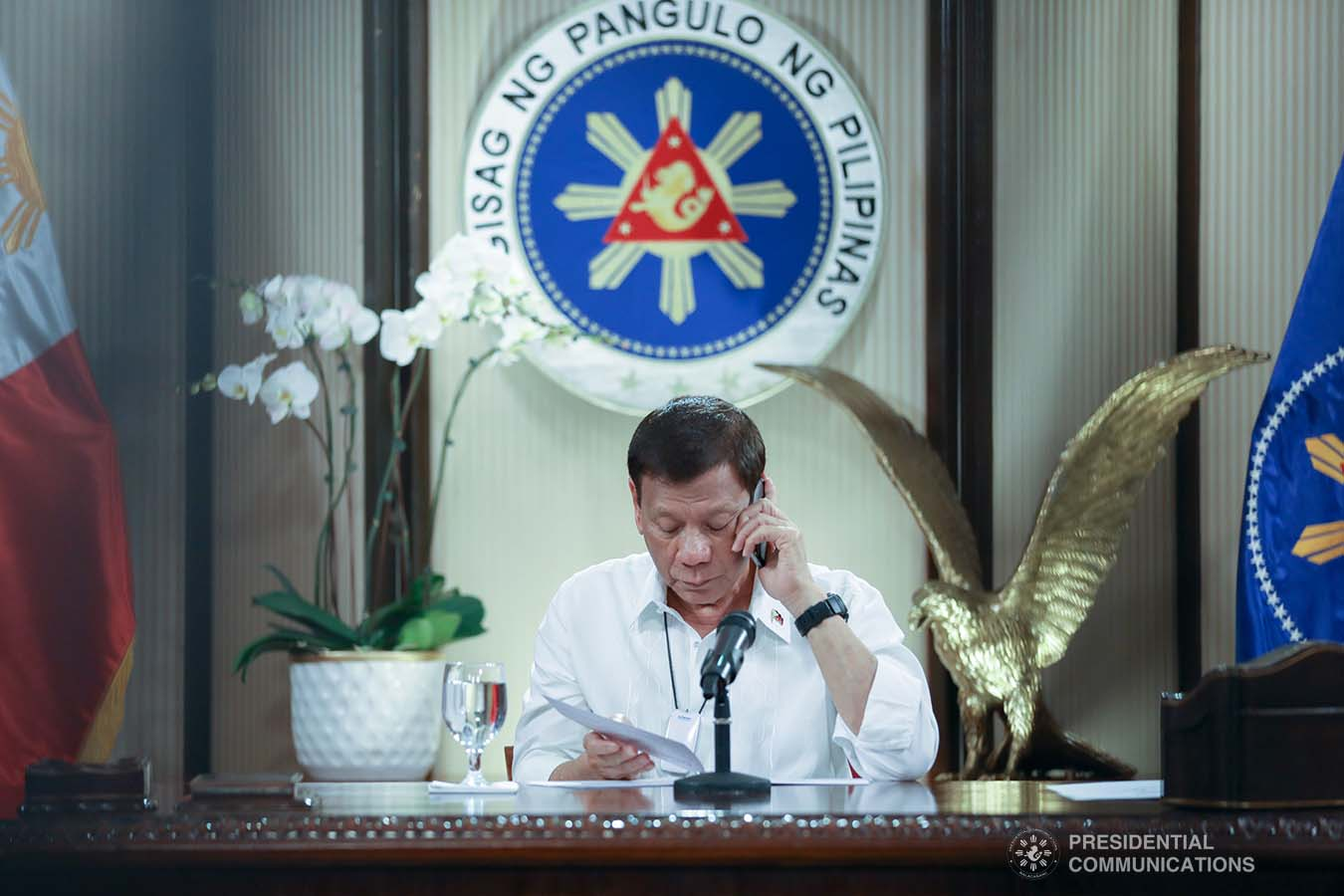 President Rodrigo Roa Duterte talks on the phone with Socialist Republic of Vietnam Prime Minister Nguyen Phuc at the Malago Clubhouse in Malacañang, Manila on May 26, 2020. KARL NORMAN ALONZO/PRESIDENTIAL PHOTO
