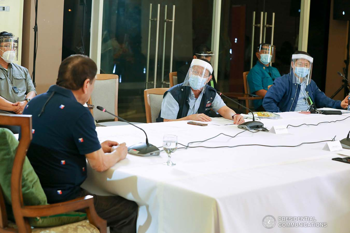 President Rodrigo Roa Duterte confers with Health Secretary Francisco Duque III during a meeting with members of the Inter-Agency Task Force on the Emerging Infectious Diseases (IATF-EID) at the Matina Enclaves in Davao City on June 4, 2020. ROBINSON NIÑAL JR./PRESIDENTIAL PHOTO