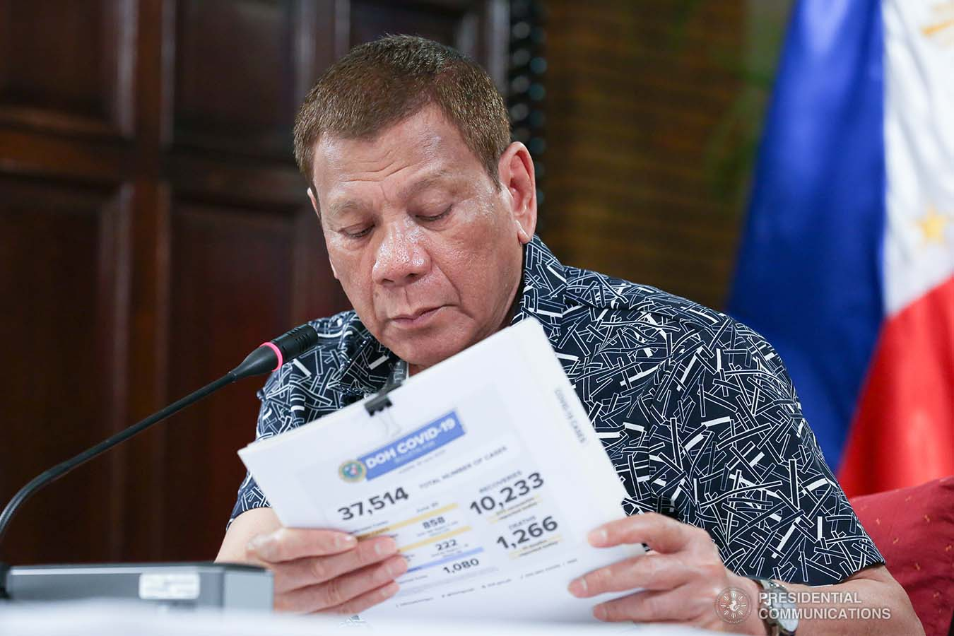 President Rodrigo Roa Duterte reviews a document during a meeting with the Inter-Agency Task Force on the Emerging Infectious Diseases (IATF-EID) core members at the Malago Clubhouse in Malacañang on June 30, 2020. ALBERT ALCAIN/PRESIDENTIAL PHOTO