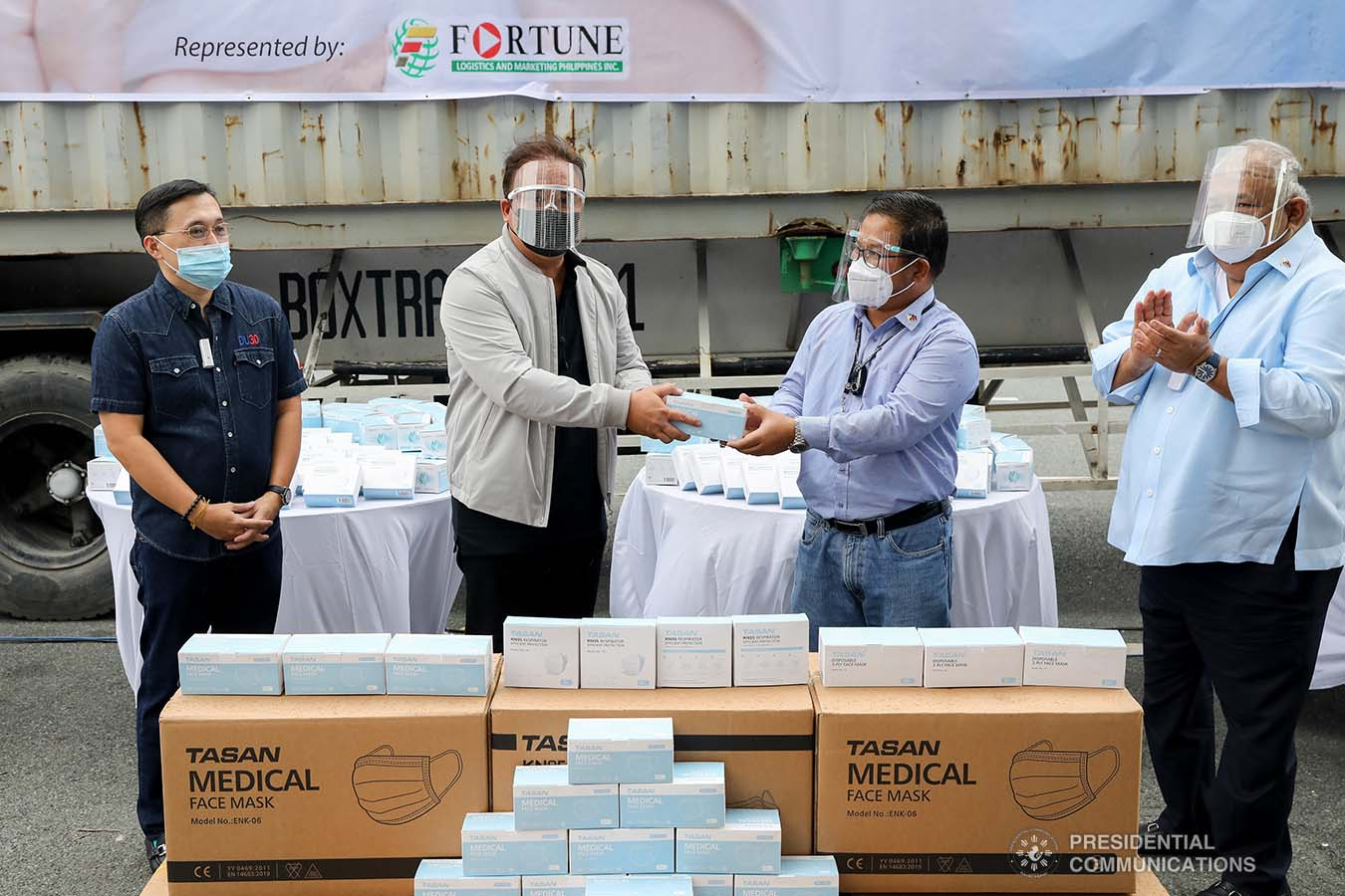 Executive Secretary Salvador Medialdea and Senator Christopher Go witness the ceremonial turnover of one million face masks between Philippine Postal Corporation Chairman Norman Fulgencio and Presidential Management Staff Assistant Secretary Joseph Encabo at the Rizal Park Hotel in Manila on September 17, 2020. REY BANIQUET/ PRESIDENTIAL PHOTOS