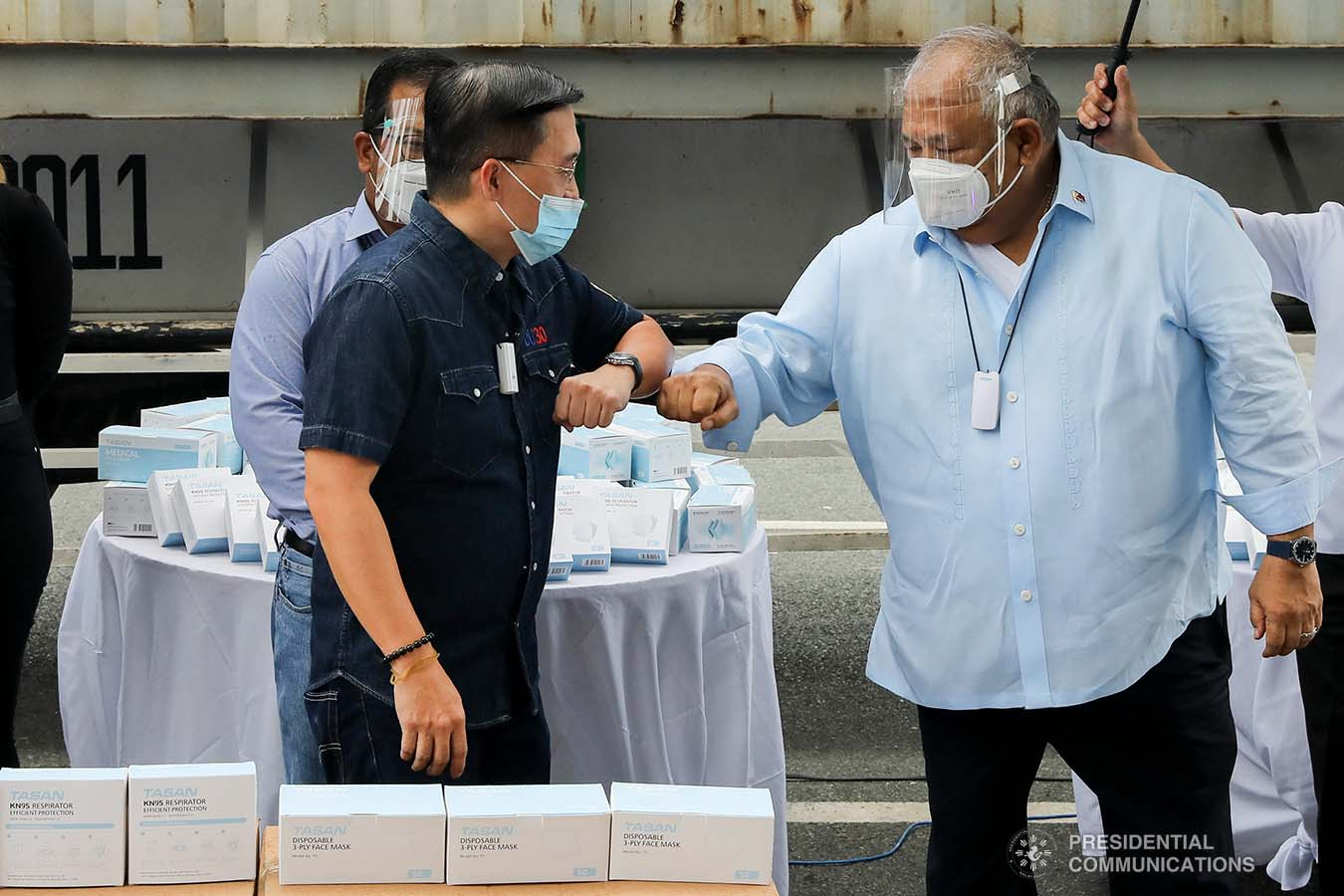 Executive Secretary Salvador Medialdea and Senator Christopher Go greet each other upon their arrival at the Rizal Park Hotel in Manila during the ceremonial turnover of the one million face masks donated by Tasan Health and Medical Tech (Shanghai) Company Limited on September 17, 2020. REY BANIQUET/ PRESIDENTIAL PHOTOS