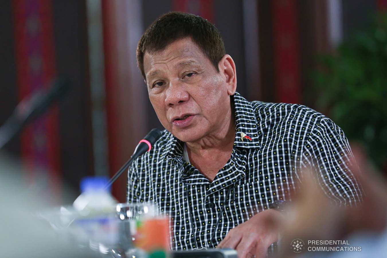 """President Rodrigo Roa Duterte delivers his remarks following a meeting with the officials of the Philippine National Police and the Armed Forces of the Philippines, discussing the impasse in Congress as he called on its members to resolve the issues on the passing of the national budget for 2021 at the Malacañang Golf (Malago) Clubhouse in Malacañang Park, Manila on October 8, 2020. Joining the meeting are Executive Secretary Salvador Medialdea, Interior and Local Government Secretary Eduardo Año, and Senator Christopher """"Bong"""" Go. ALBERTO ALCAIN/ PRESIDENTIAL PHOTO"""