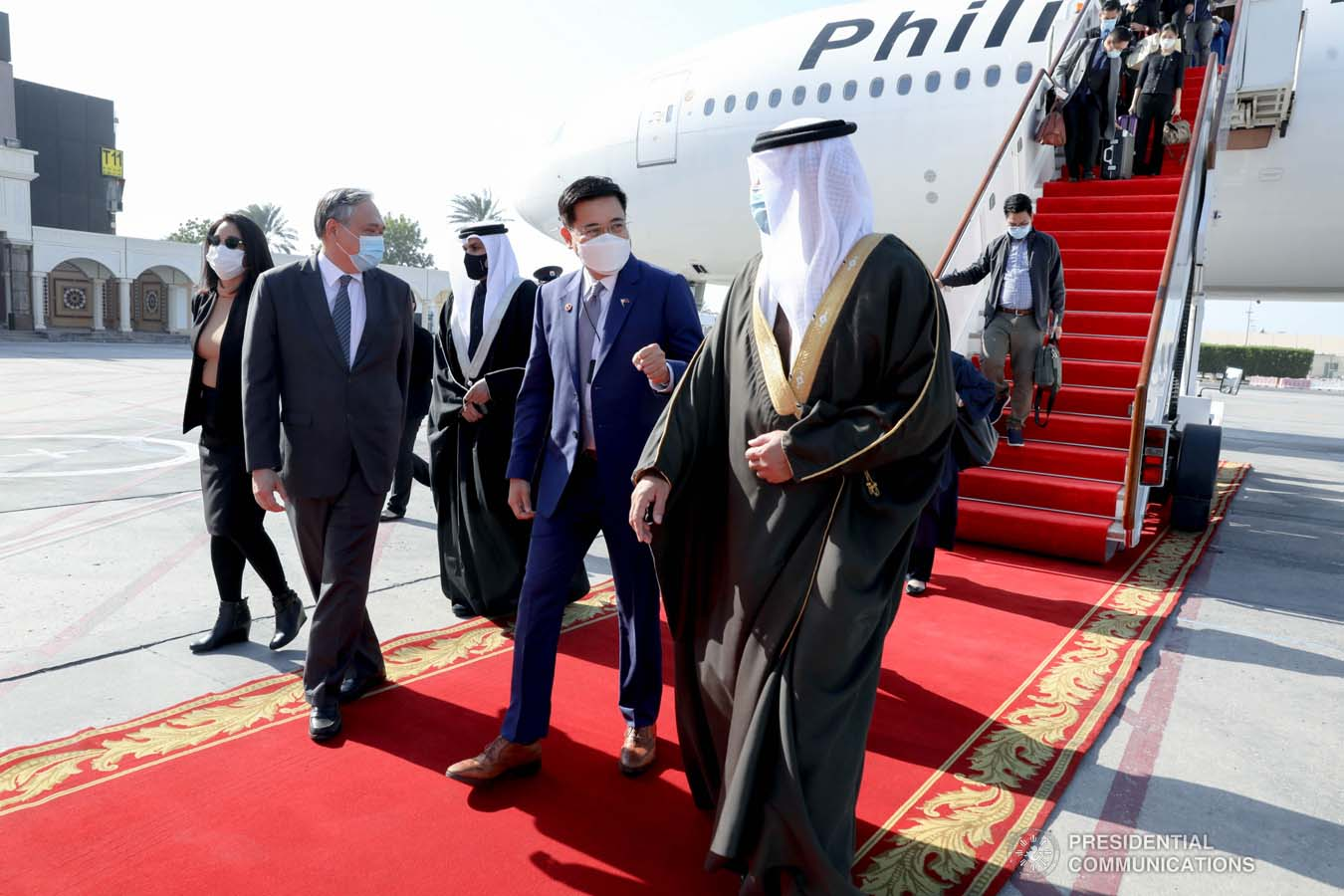 """WARM WELCOME. Kingdom of Bahrain Assistant Foreign Minister Abdulla bin Faisal bin Jabur Al Doseri warmly welcomed the 14-man delegation of the Philippines led by the Chief of Presidential Protocol and Presidential Assistant on Foreign Affairs (PAFA) Robert E.A. Borje at the Bahrain International Airport on December 28, 2020. Joining the Philippine delegation are Foreign Affairs Undersecretary for Migrant Workers' Affairs Sarah Arriola and Presidential Communications Assistant Secretary for Global Media and Public Affairs JV Arcena. During the meeting of the two officials, Special Envoy Borje conveyed President Rodrigo Roa Duterte's gratitude for the """"solid partnership"""" in upholding the rights and welfare of migrant workers that has """"transformed the lives of many for the better' and expressed the President's keen interest in broadening and deepening cooperation with Bahrain in areas of mutual interest, including in trade and investments, education, ICT, agriculture and public health, including diagnostics, management and treatment of COVID-19. President Duterte has designated PAFA Borje as Special Envoy for the goodwill mission for a series of intergovernmental meetings with officials of the Kingdom and to undertake Assistance-to-Nationals (ATN) and repatriation programs. Kalinga at Malasakit for Overseas Filipino Workers remain a focus area under the Duterte Administration. This is PAFA Borje's second designation as Special Envoy to the Kingdom of Bahrain. President Duterte previously appointed PAFA Borje as Special Envoy to Bahrain, Kingdom of Saudi Arabia and Tunisia in 2019. PRESIDENTIAL PHOTO"""