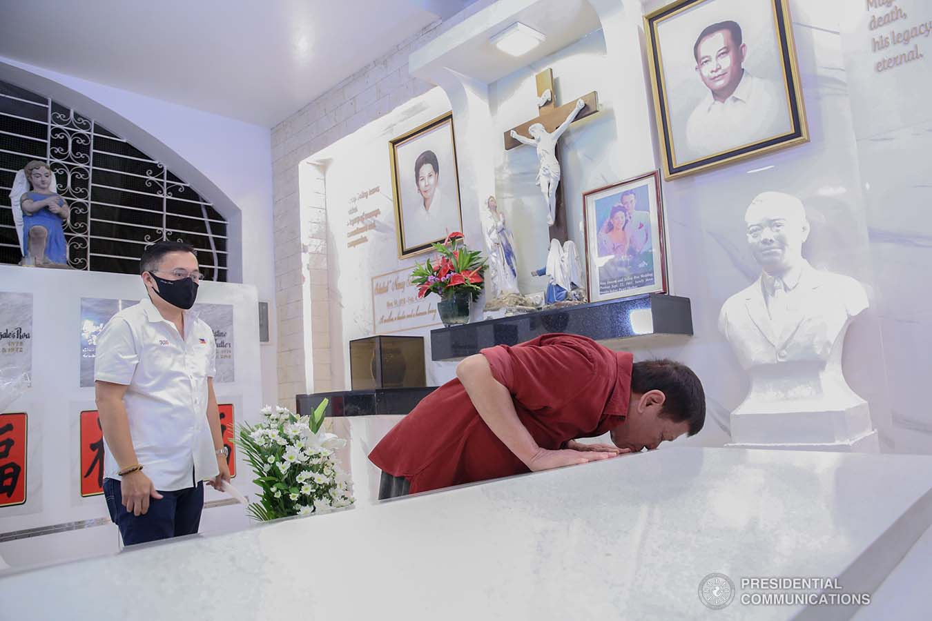 President Rodrigo Roa Duterte kisses the resting place of his father, Vicente Duterte, the former governor of then undivided Davao Province, during his visit at the Roman Catholic Cemetery in Davao City on February 21, 2021. The President consistently visits his departed loved ones even when he was still mayor of Davao City. ALBERTO ALCAIN/ PRESIDENTIAL PHOTO