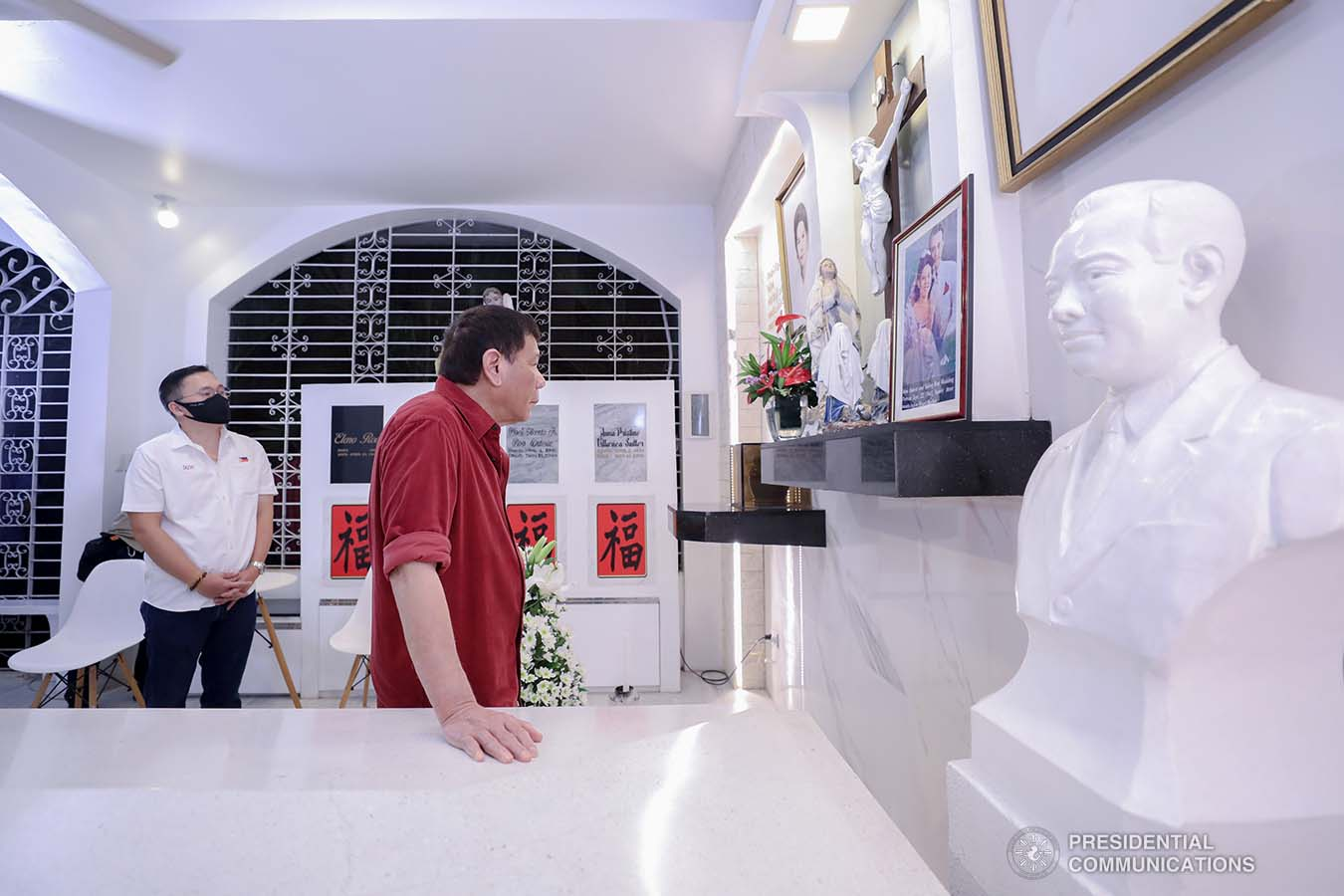 President Rodrigo Roa Duterte is accompanied by Senator Christopher Lawrence Go as he visits the resting place of his parents, Vicente Duterte, the former governor of then undivided Davao Province, and Soledad Duterte, one of Davao's respected civic leaders, at the Roman Catholic Cemetery in Davao City, before heading to Manila, on February 21, 2021. The President consistently visits his departed loved ones even when he was still mayor of Davao City. RICHARD MADELO/ PRESIDENTIAL PHOTO