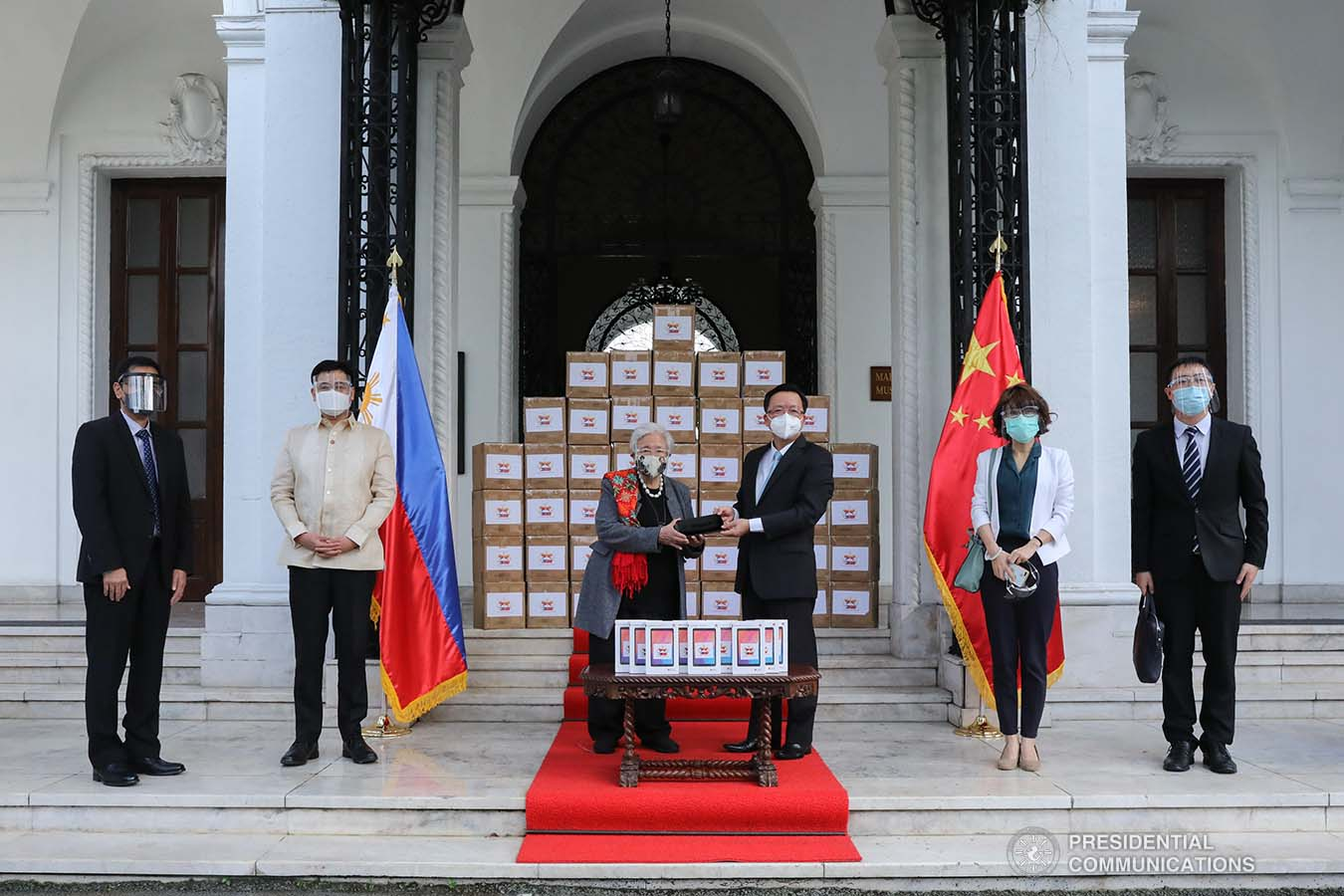 TABLETS FOR LAST MILE SCHOOLS. Secretary of Education Leonor Briones receives 2,000 tablets from Chinese Ambassador Huang Xilian. The tablets will be used for DepEd's blended distance learning program and will benefit Last Mile Schools in far-flung areas.Also present during the ceremonial turnover were Presidential Assistant for Foreign Affairs Robert E.A. Borje and representatives from the Chinese Embassy and the Department of Education. PRESIDENTIAL PHOTOS
