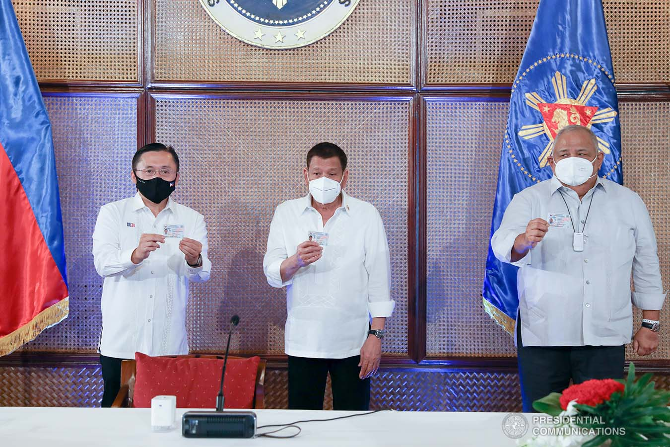 President Rodrigo Roa Duterte together with Senator Christopher Lawrence Go and Executive Salvador Medialdea show their government-issued identification cards at the Malacañan Palace on March 3, 2021. KARL NORMAN ALONZO/ PRESIDENTIAL PHOTO