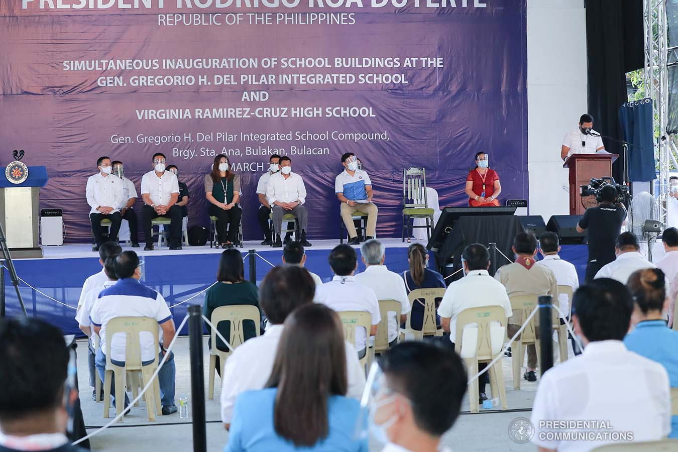 President Rodrigo Roa Duterte listens as Bulacan Governor Daniel Fernando delivers his welcome remarks during the inauguration of the newly constructed Gen. Gregorio H. Del Pilar Integrated School and Virginia Ramirez-Cruz High School buildings in Bulakan, Bulacan on March 4, 2021. ALFRED FRIAS/ PRESIDENTIAL PHOTO