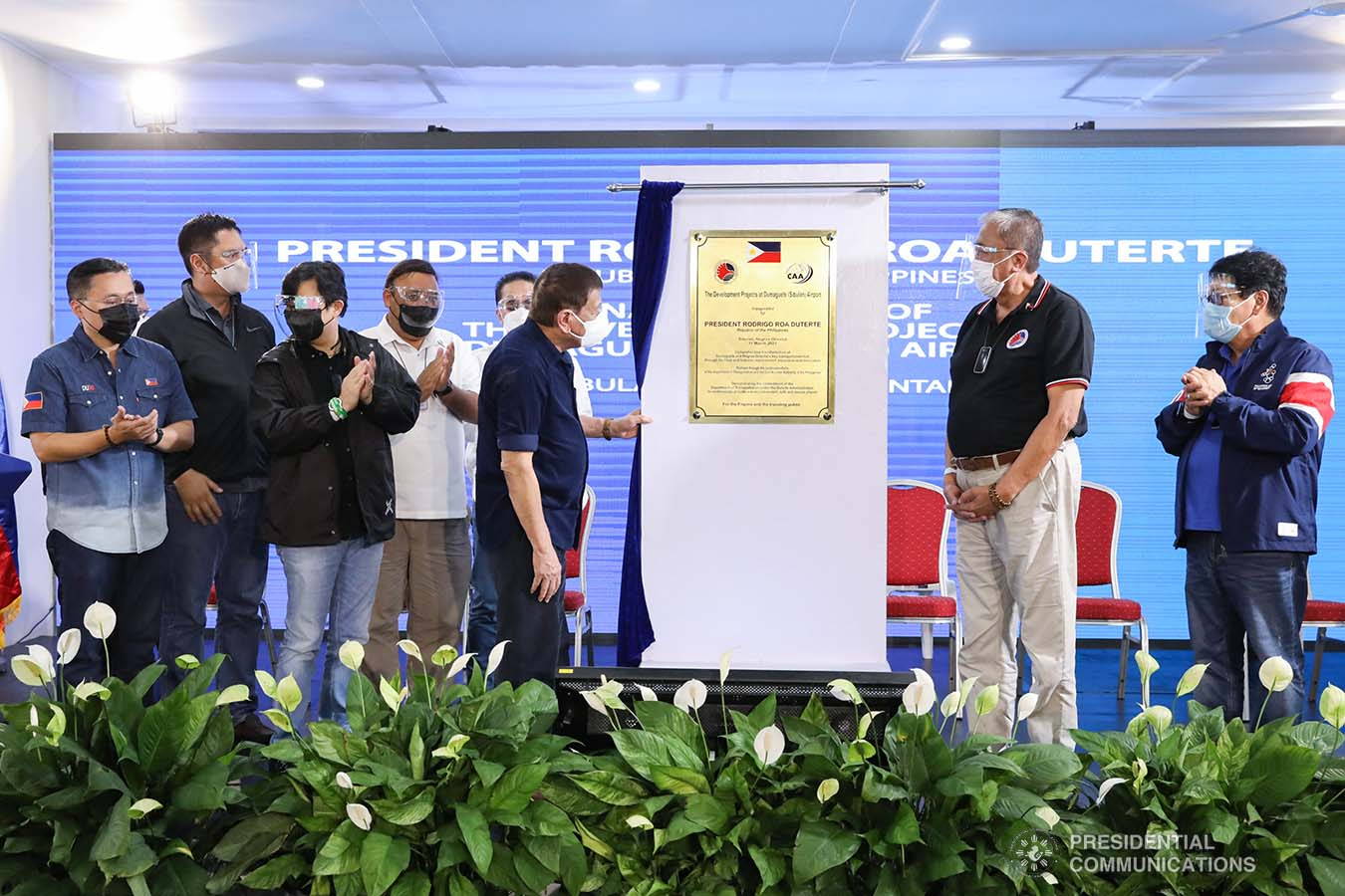 """President Rodrigo Roa Duterte leads the unveiling of the marker of the development projects at Dumaguete (Sibulan) Airport in Sibulan, Negros Oriental on March 11, 2021. The President was assisted by Senator Christopher Lawrence """"Bong"""" Go, Transportation Secretary Arthur Tugade, Presidential Assistant for the Visayas Secretary Michael Lloyd Dino, and Civil Aviation Authority of the Philippines Director General Jim Sydiongco. Also present are Presidential Communications and Operations Office Secretary Martin Andanar, Presidential Spokesperson Herminio """"Harry"""" Roque Jr., Chief Presidential Legal Counsel Salvador """"Sal"""" Panelo, Labor and Employment Secretary Silvestre Bello III, and Negros Oriental Governor Roel Degamo. TOTO LOZANO/ PRESIDENTIAL PHOTO"""