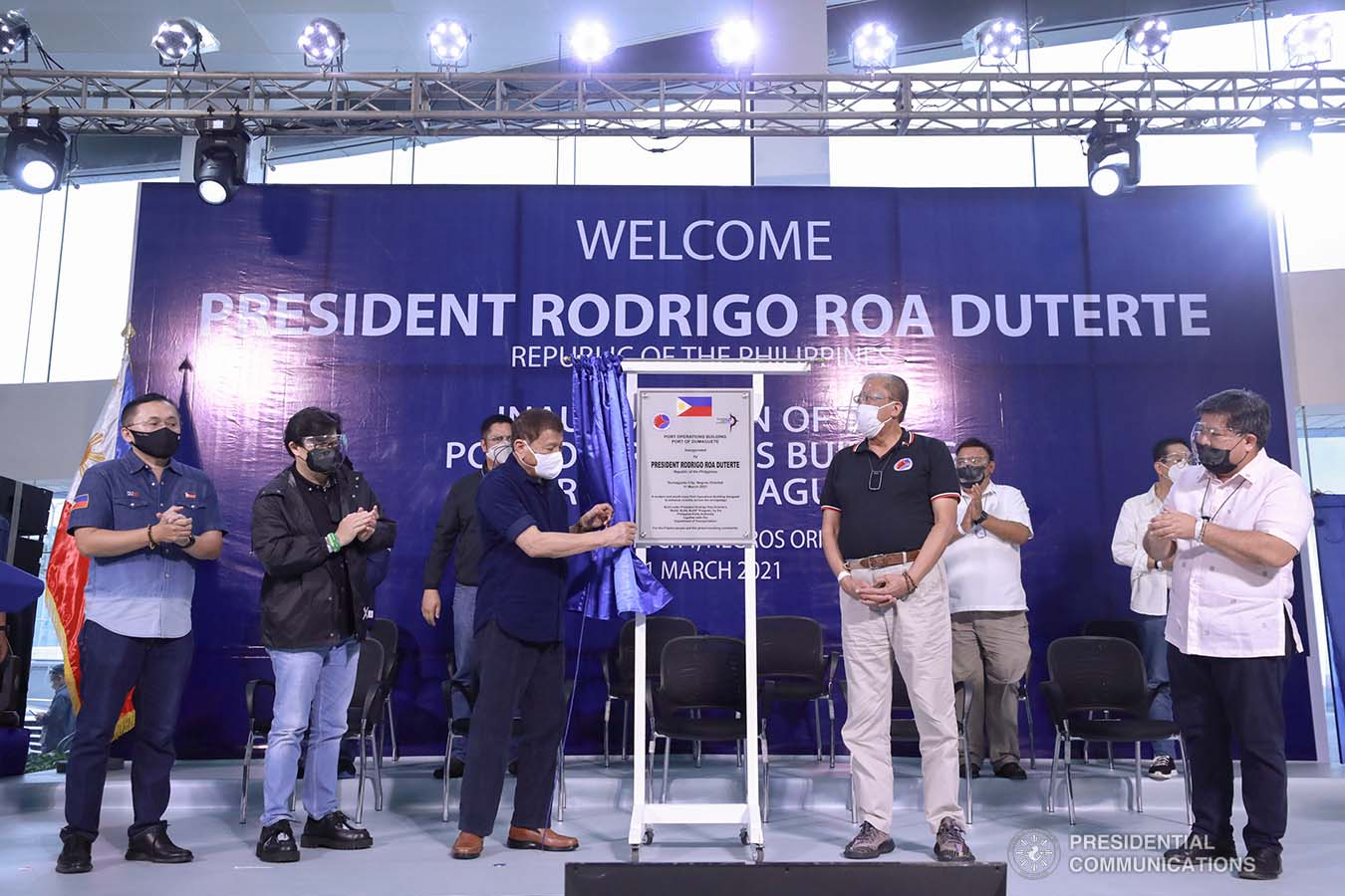President Rodrigo Roa Duterte leads the unveiling of the marker of the Port Operations Building at the Port of Dumaguete in Dumaguete City, Negros Oriental on March 11, 2021. The President was assisted by Senator Christopher Lawrence Go, Transportation Secretary Arthur Tugade, Presidential Assistant for the Visayas Secretary Michael Lloyd Dino, and Philippine Ports Authority General Manager Jay Daniel Santiago. ACE MORANDANTE/ PRESIDENTIAL PHOTO