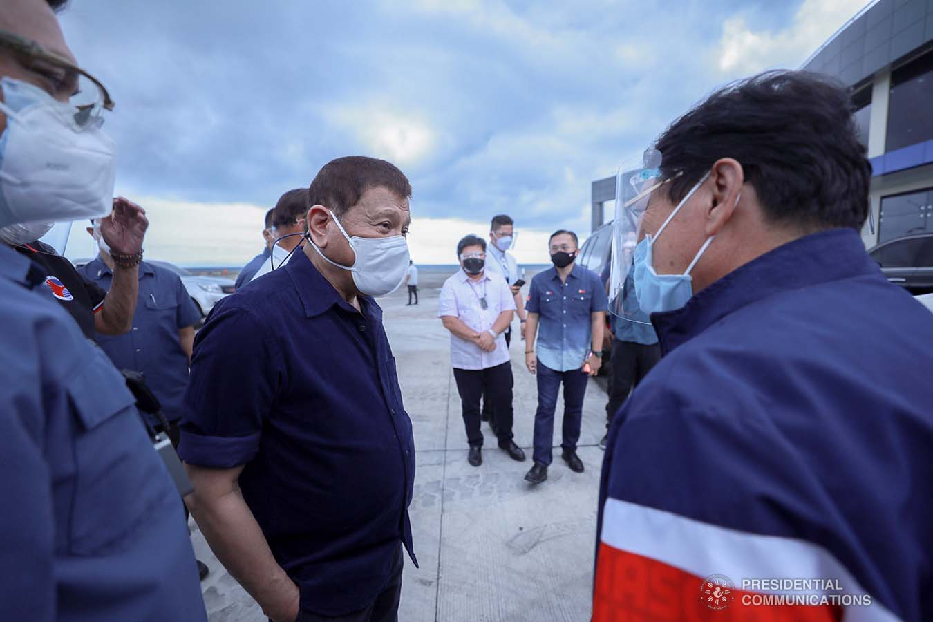 President Rodrigo Roa Duterte discusses matters with Labor and Employment Secretary Silvestre Bello III after leading the inauguration of the Port Operations Building at the Port of Dumaguete in Dumaguete City, Negros Oriental on March 11, 2021. ACE MORANDANTE/ PRESIDENTIAL PHOTO