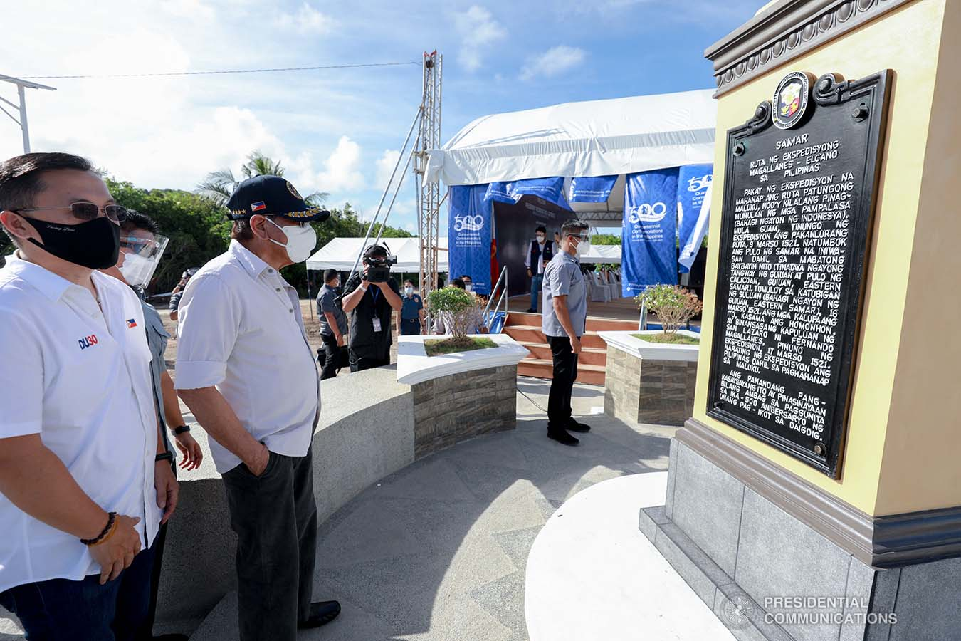 President Rodrigo Roa Duterte, accompanied by Senator Christopher Lawrence Go, looks at the Quincentennial Marker after unveiling it during his attendance in the 500th Anniversary of the Philippine Part in the First Circumnavigation of the World held at the Veterans Park Calicaon Island in Guiuan, Eastern Samar  on March 18, 2021. ACE MORANDANTE/ PRESIDENTIAL PHOTO