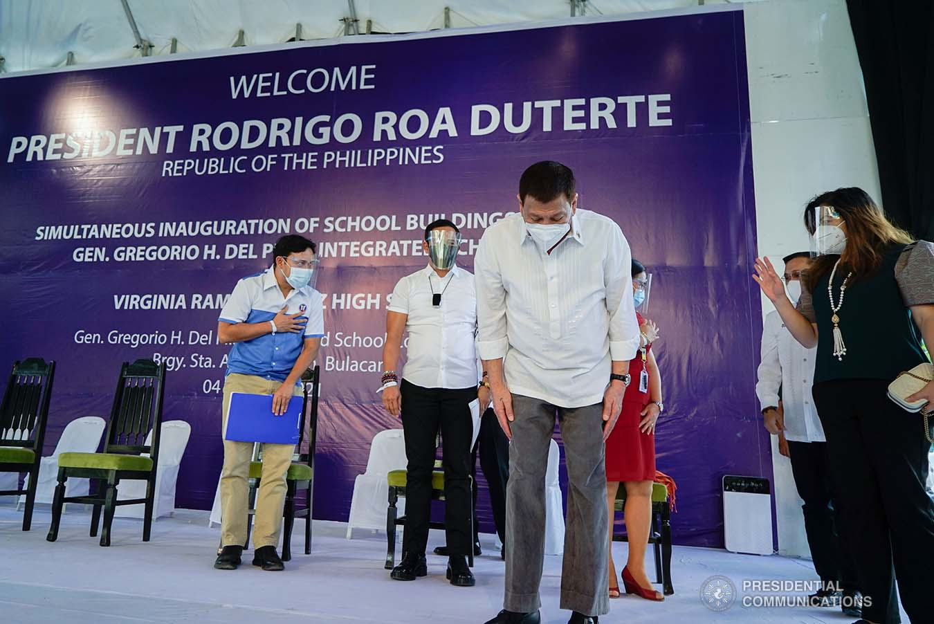 President Rodrigo Roa Duterte shows a gesture of respect as he takes center stage during the inauguration of the newly constructed Gen. Gregorio H. Del Pilar Integrated School and Virginia Ramirez-Cruz High School buildings in Bulakan, Bulacan on March 4, 2021. KING RODRIGUEZ/ PRESIDENTIAL PHOTO
