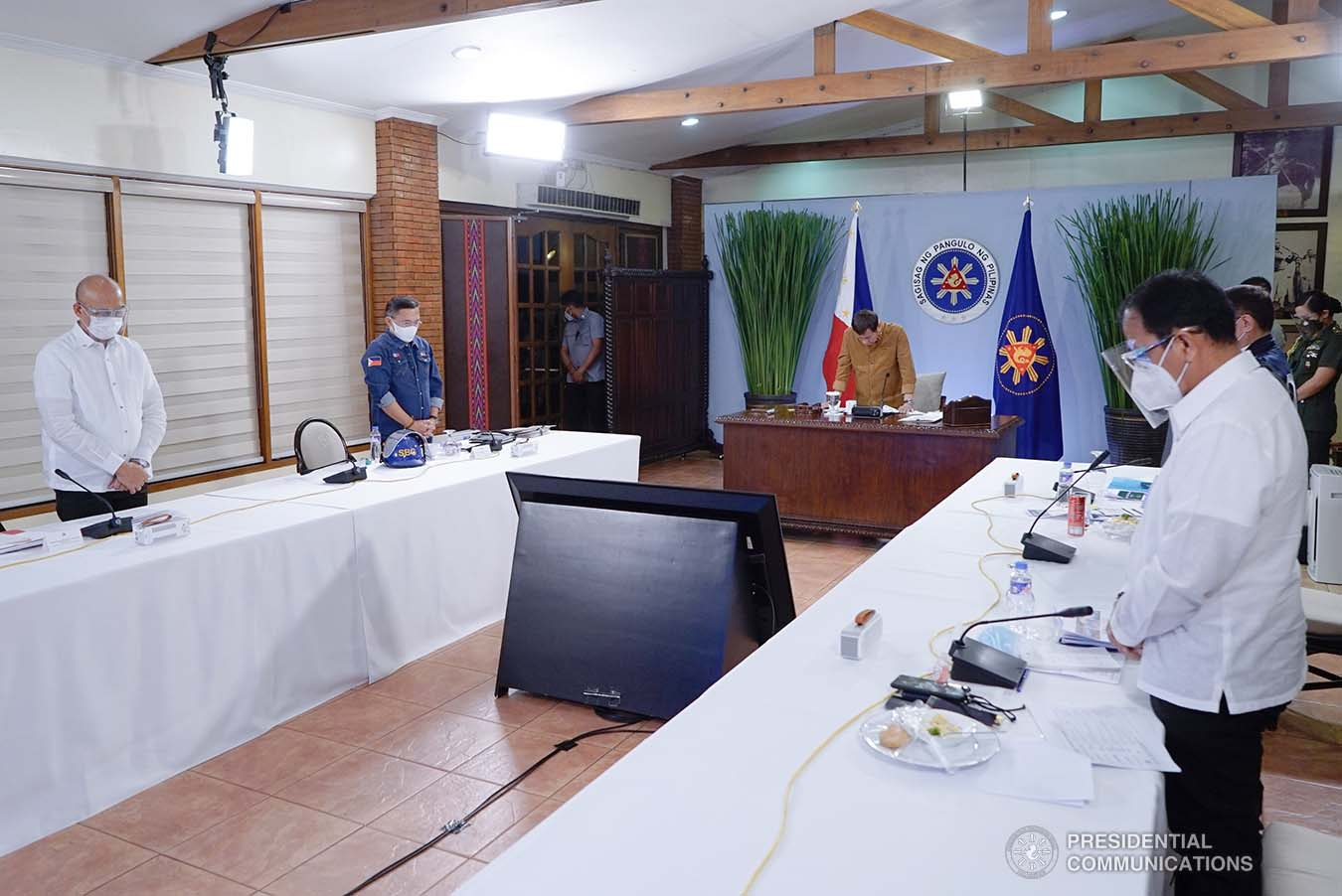 President Rodrigo Roa Duterte together with his Cabinet members bow their heads in prayer for the departed soul of Presidential Legislative Liaison Secretary Adelino Sitoy who succumbed to Covid-19 during the meeting with the Inter-Agency Task Force on the Emerging Infectious Diseases (IATF-EID) core members at the Malacañang Golf (Malago) Clubhouse in Malacañang Park, Manila on April 15, 2021. KING RODRIGUEZ/ PRESIDENTIAL PHOTO