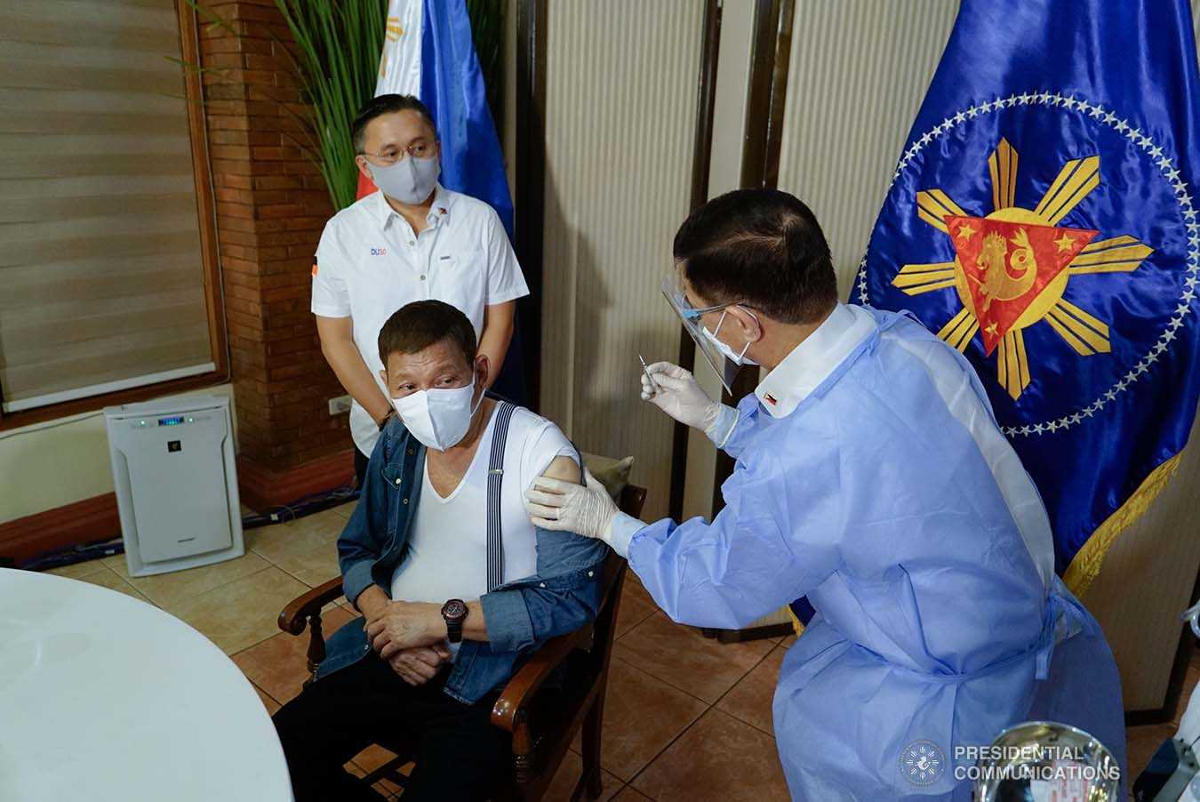 President Rodrigo Roa Duterte receives a shot of Covid-19 vaccine administered by Health Secretary Francisco Duque III at the Malacañang Golf (Malago) Clubhouse in Malacañang Park, Manila on May 3, 2021. KING RODRIGUEZ/ PRESIDENTIAL PHOTO