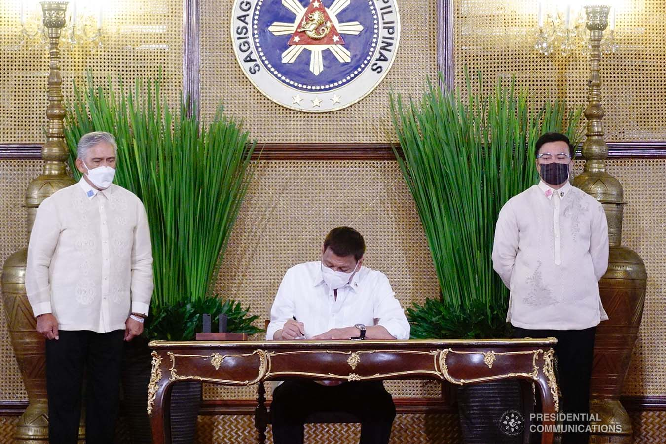 President Rodrigo Roa Duterte leads the re-enactment of the signing of several bills held at the Malacañang Palace on June 16, 2021. ARMAN BAYLON/ PRESIDENTIAL PHOTO