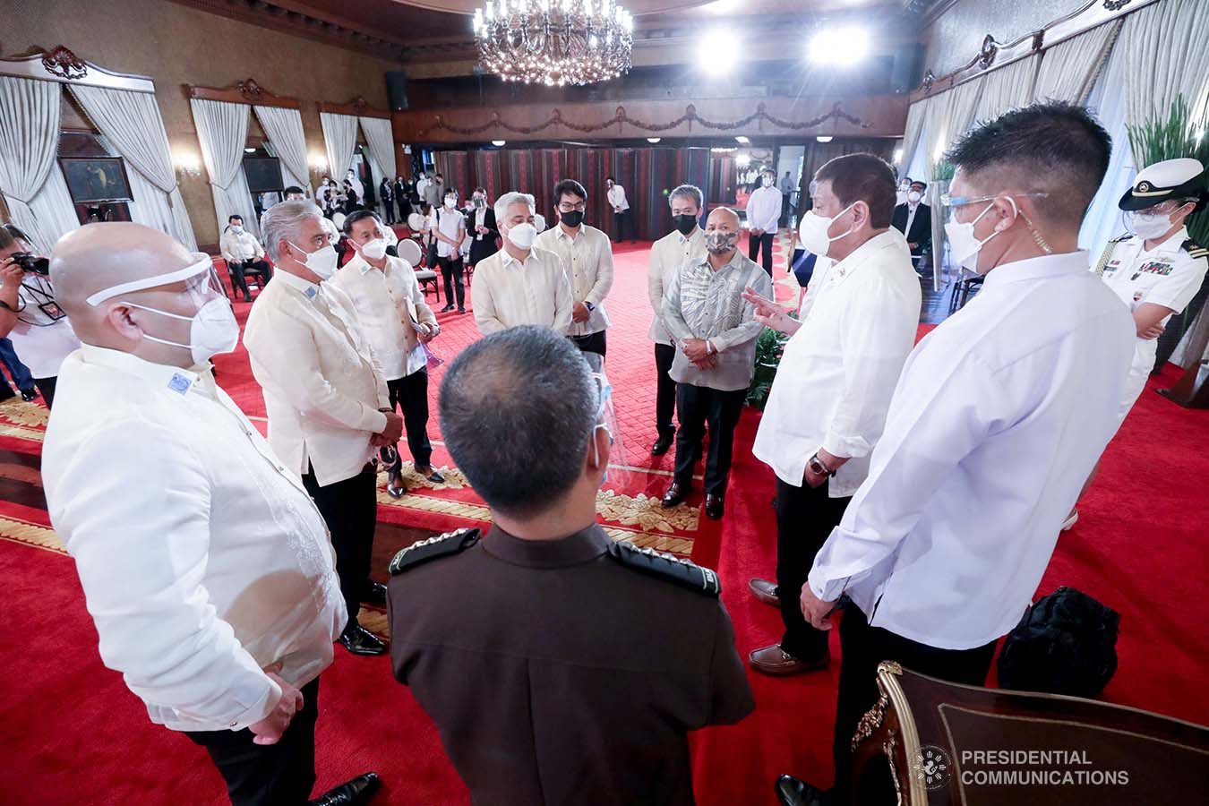 President Rodrigo Roa Duterte discusses matters with  legislators and officials from various agencies on the sidelines following the ceremonial re-enactment of the signing of bills at the Malacañang Palace on June 16, 2021. TOTO LOZANO/ PRESIDENTIAL PHOTO